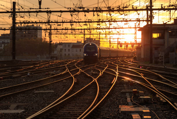 train at dusk - rail stock photos and pictures