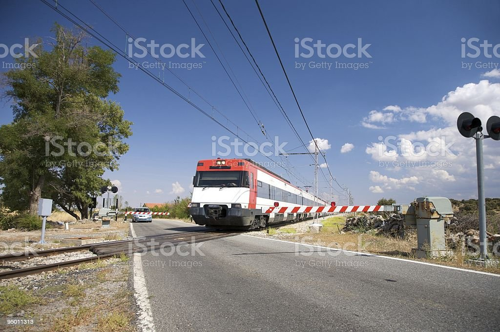 train at level crossing stock photo