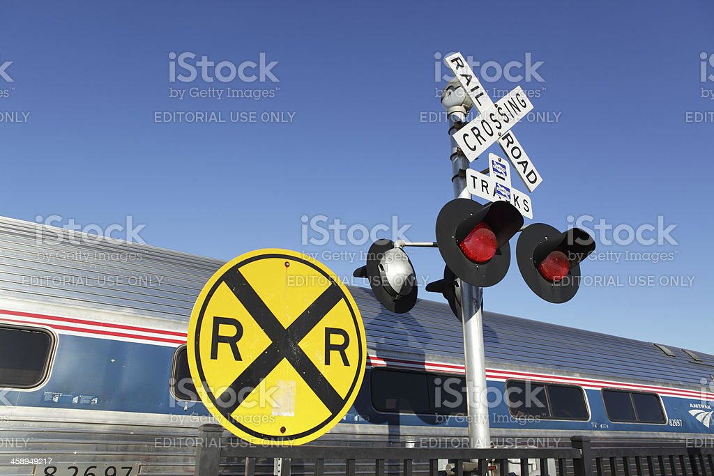 AMTRAK train at station in Rutland Vermont railroad crossing sign stock photo