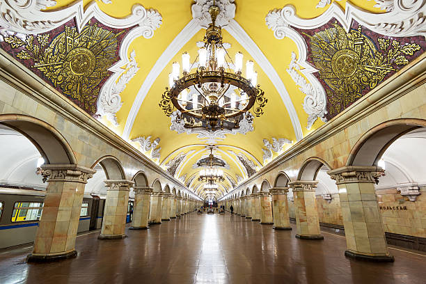 Train at the metro station Komsomolskaya in Moscow, Russia Metro station Komsomolskaya is a great monument of the Soviet era. moscow russia stock pictures, royalty-free photos & images