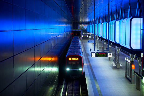 Train at the Subway station with blue lights at University on the Speicherstadt area in Hamburg stock photo