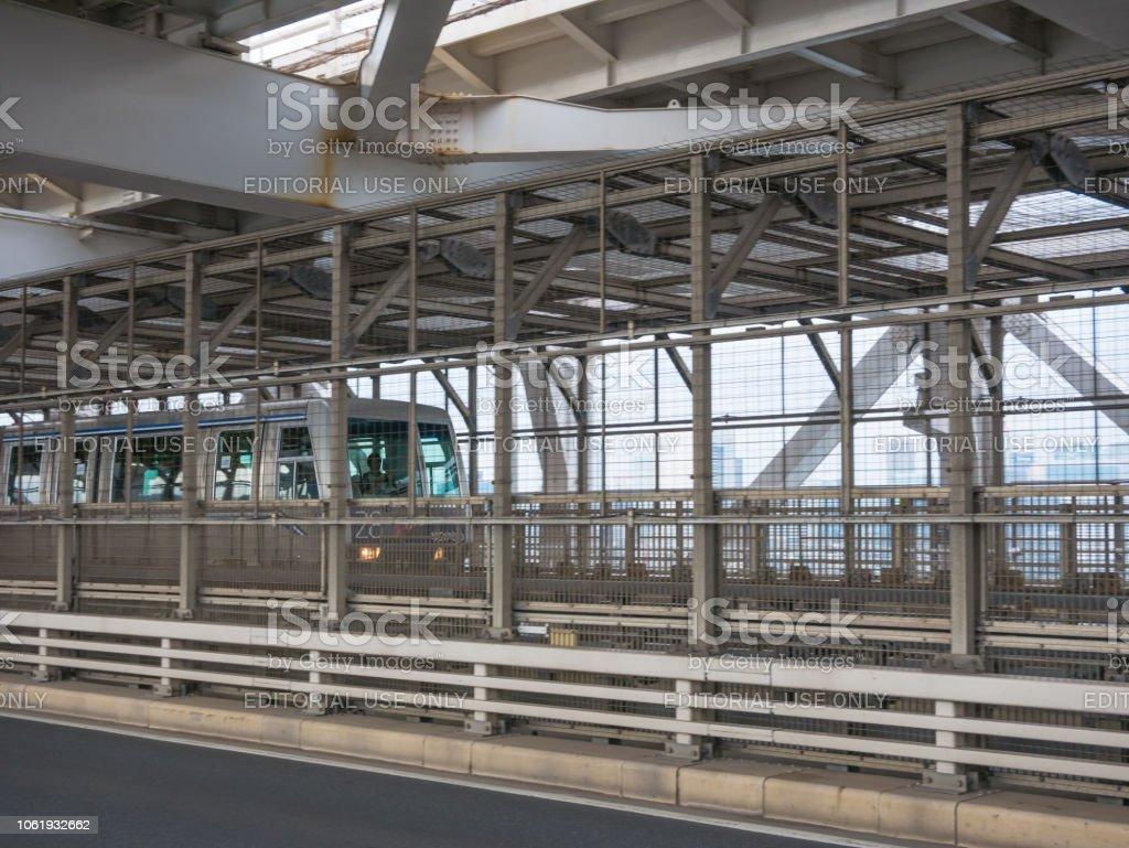 Train at Yurikamome line on the Rainbow bridge in Tokyo, Japan stock photo