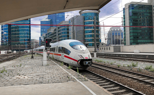 Brussels, Belgium - June 2018: ICE train between Netherlands and Germany at a platform in the Brussels North railway station, showing the office buildings of the city in the background behind the high speed train