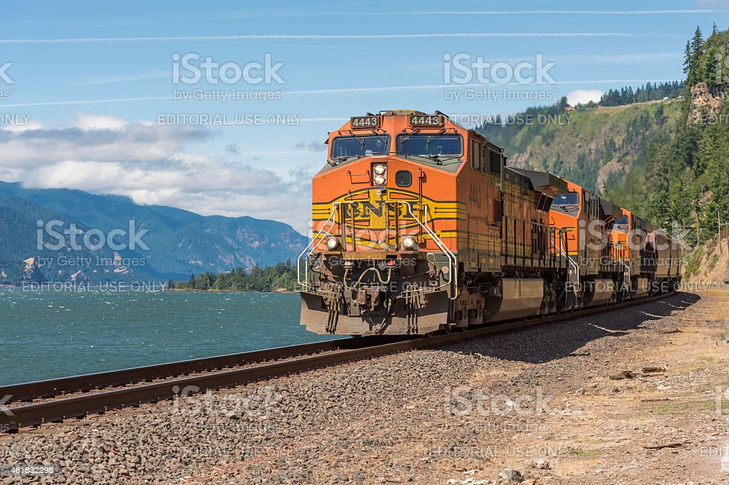 Train Bnsf By Columbia River Washington State And Oregon Background