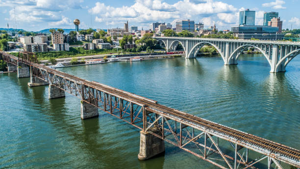Train Bridge and Road Bridge Train Bridge and Road Bridge into Knoxville, Tennessee. tennessee stock pictures, royalty-free photos & images