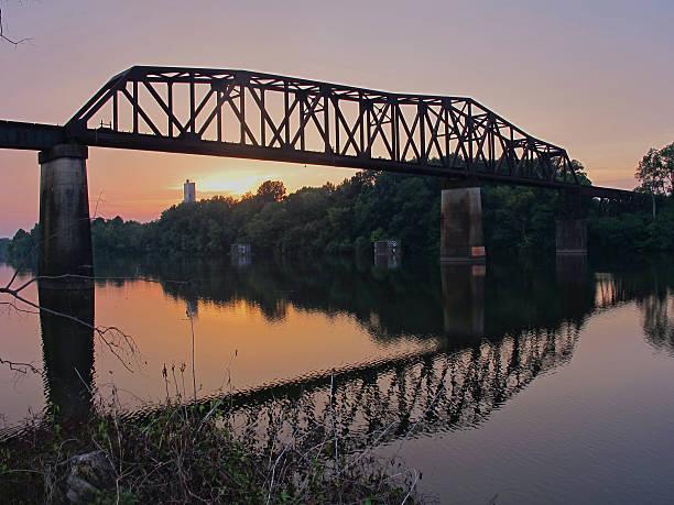 train bridge reflections at sunset - alabama stok fotoğraflar ve resimler