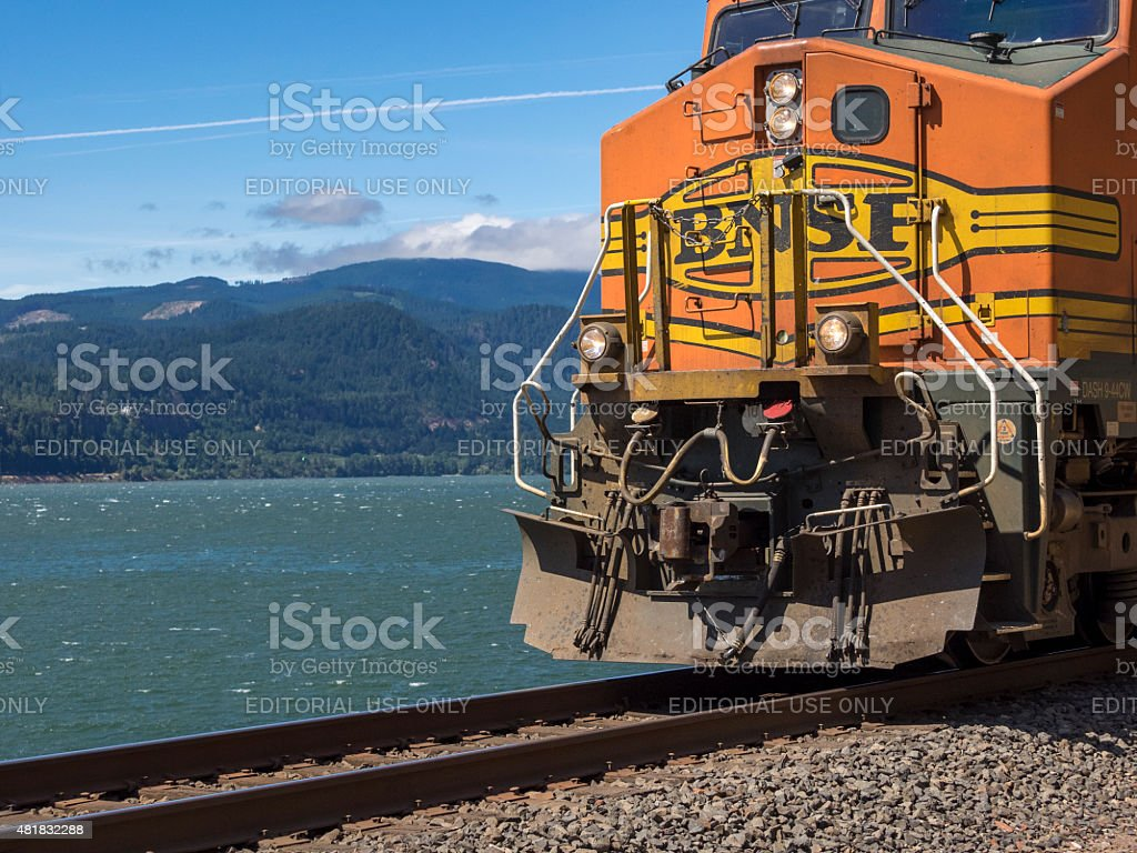 Bnsf Train By Columbia River Washington State With Oregon Background