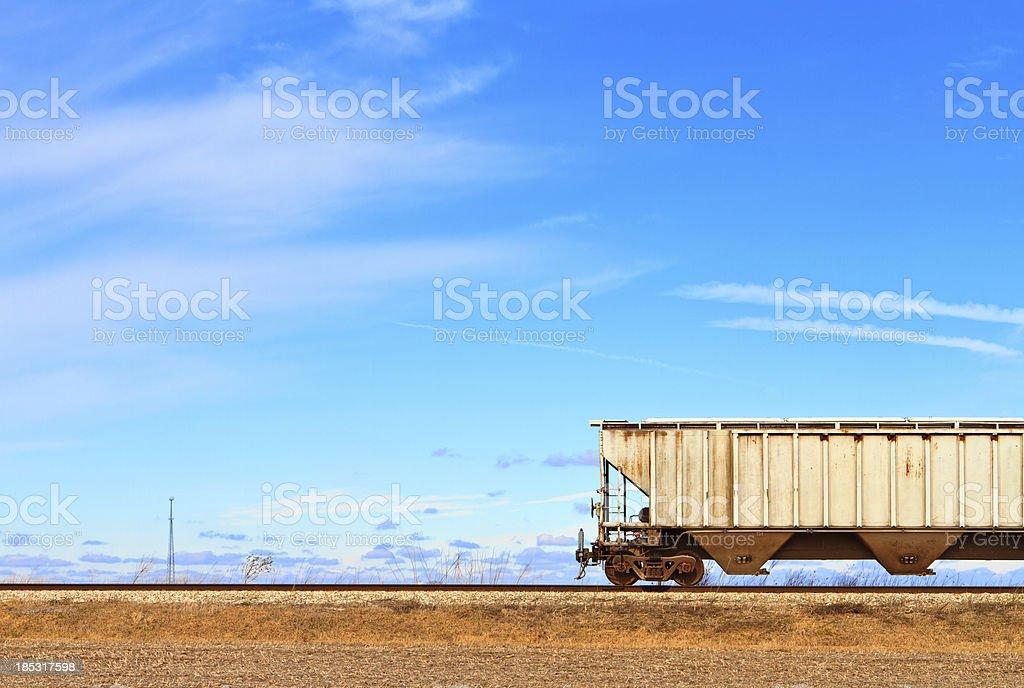Train car on railroad tracks stock photo