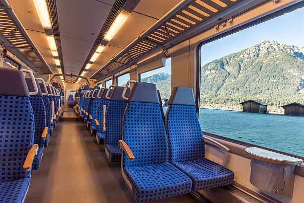 train chairs and mountain view through the window - järnvägsvagn tåg bildbanksfoton och bilder