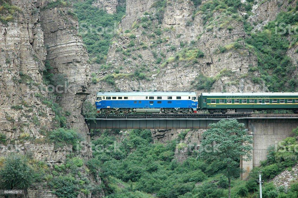 Train crossing Bridge over valley stock photo