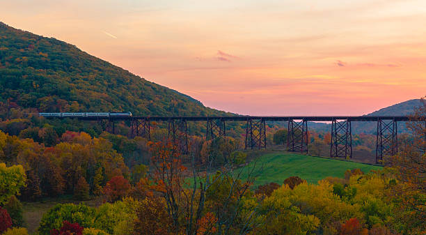 Train Crossing Bridge A commuter train crosses the Moodna Viaduct in Cornwall, New York. pennsylvania stock pictures, royalty-free photos & images