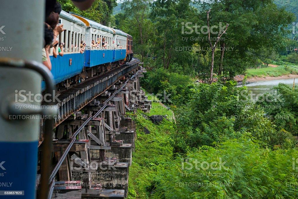 Train crossing Krasae Viaduct in Kanchanaburi, Thailand stock photo
