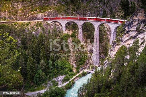 istock Train crossing Landwasser Viaduct on raethian railway in Filisur – Albula, Graubunden, Switzerland 1257480876