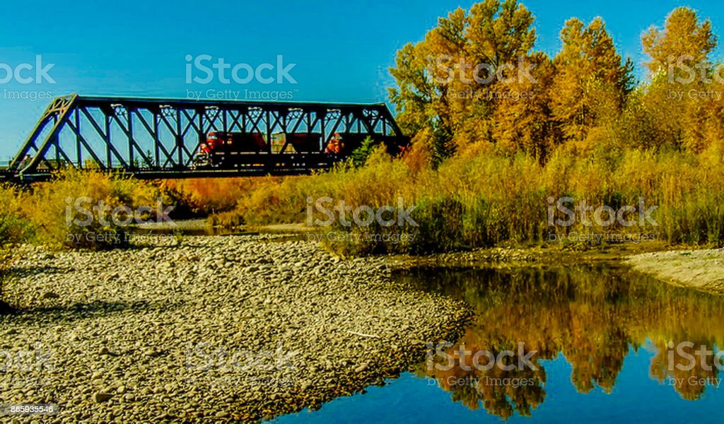 Train crossing the Bow River stock photo