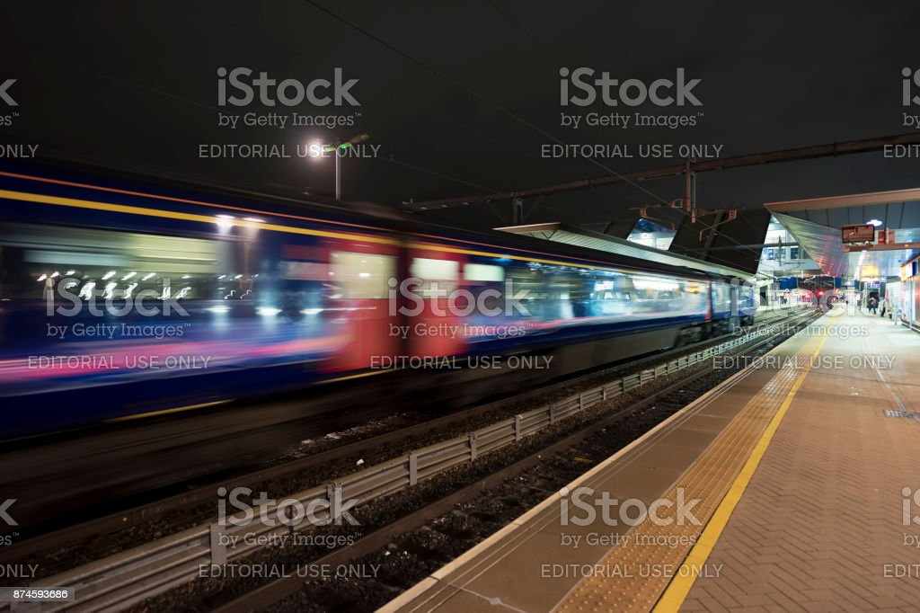 Train departing Reading station stock photo