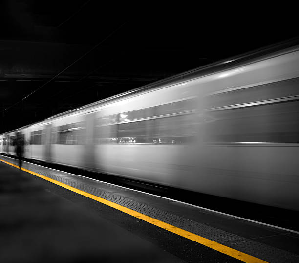Train departing station with passenger rushing towards it - Photo