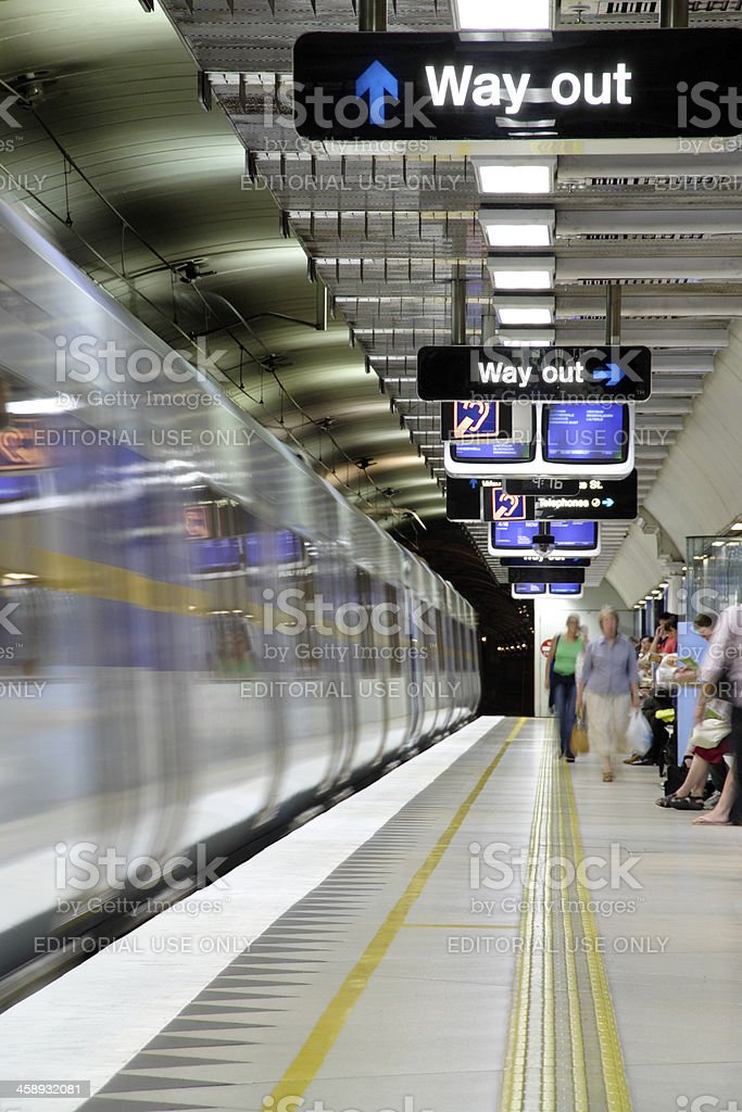 Train departing underground metro station royalty-free stock photo