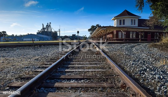 istock Train Depot and Tracks in Small Town 491244242