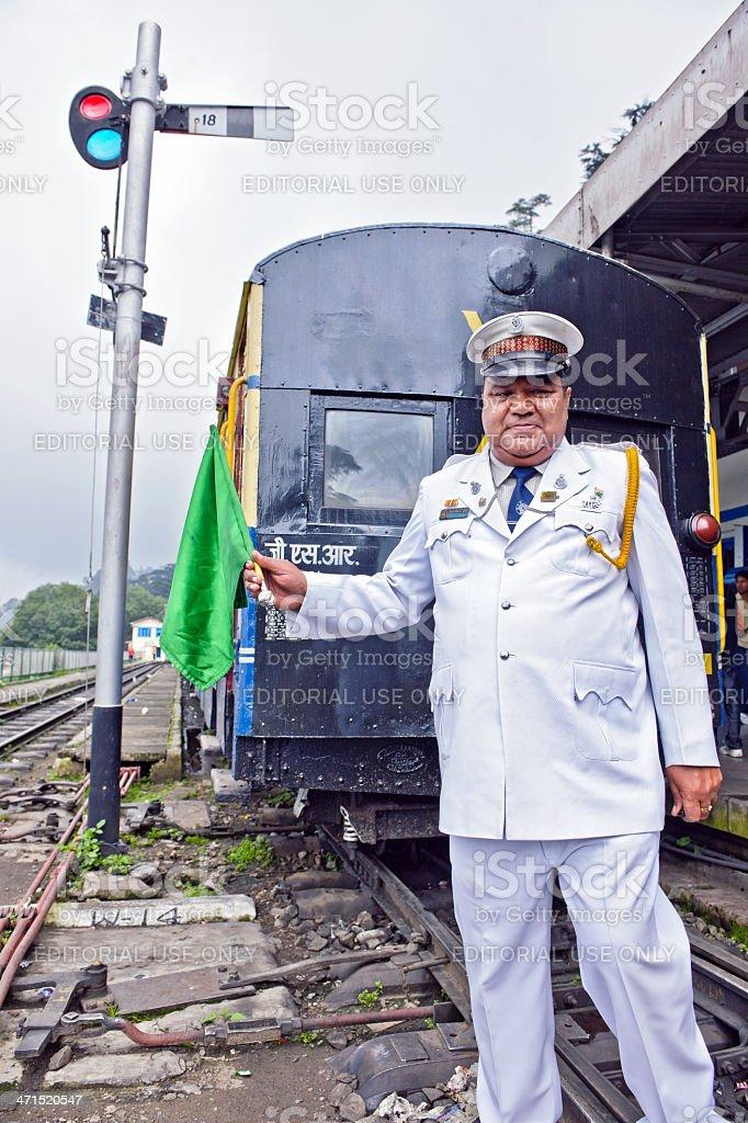 Train Dispatcher on Shimla Railway Station India royalty-free stock photo