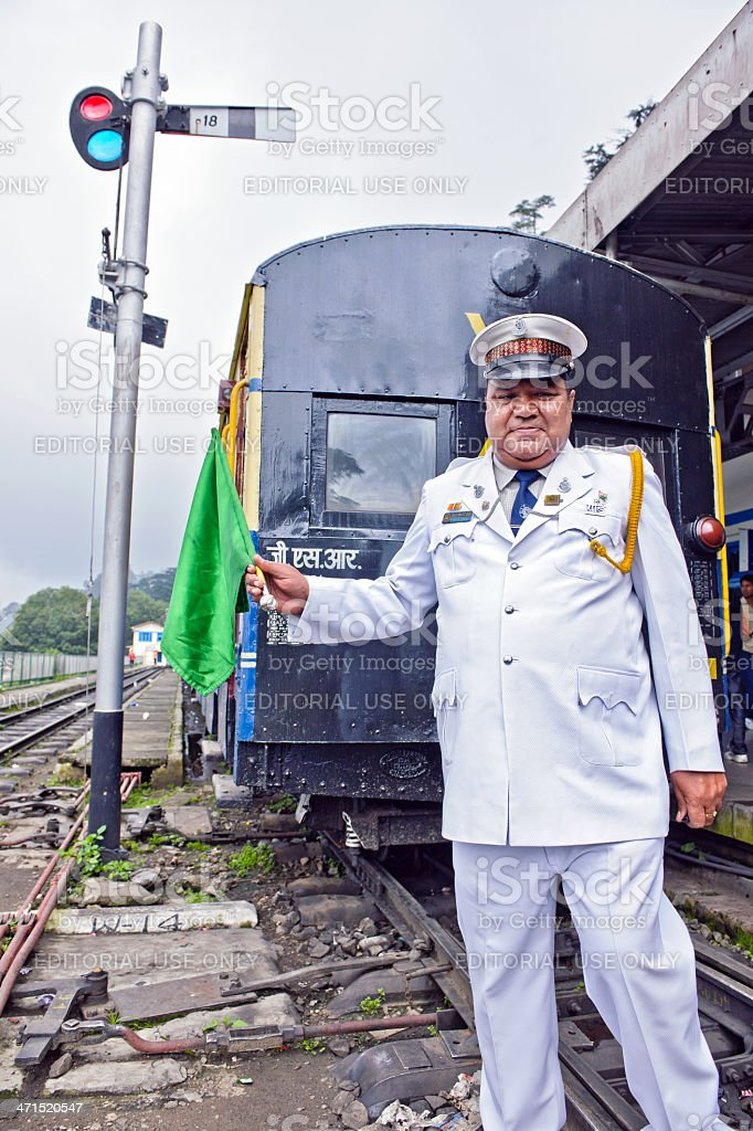Train Dispatcher on Shimla Railway Station India stock photo