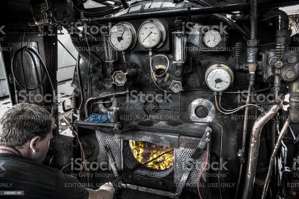 Train Driver Fuels Steam Train stock photo