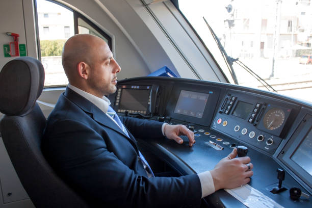 train driver in cabin - transport conductor stock photos and pictures