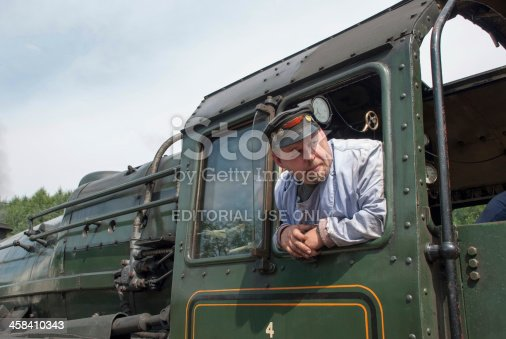 Levisham, United Kingdom aa July 26, 2006: Historical Steam Trainaas driver looking to chief of station for departure.