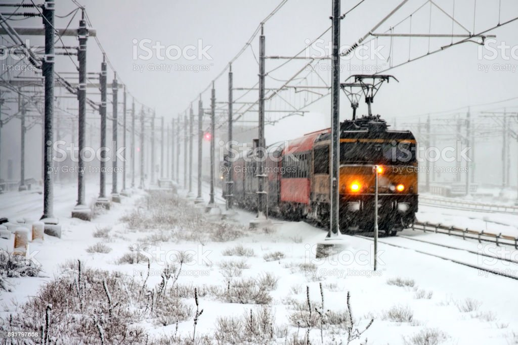 Train driving in severe snowstorm in Amsterdam Netherlands stock photo