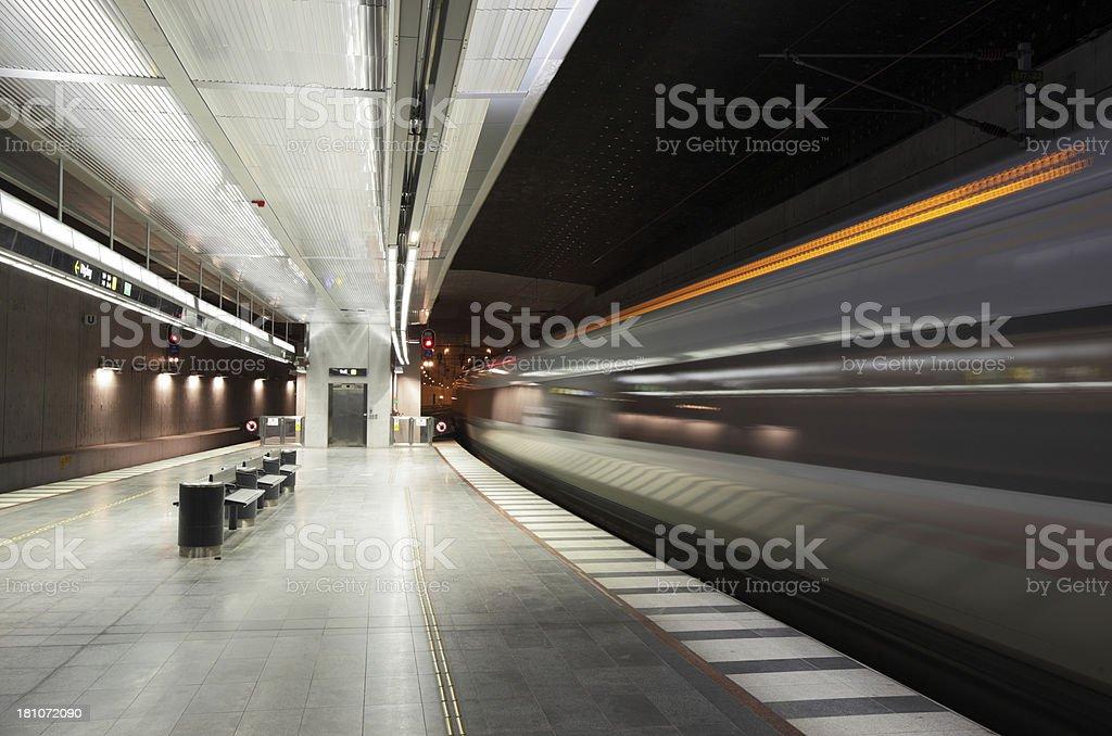 Train enters railway station royalty-free stock photo