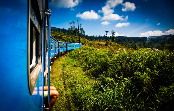 train from Nuwara Eliya to Kandy among tea plantations in the highlands of Sri Lanka stock photo