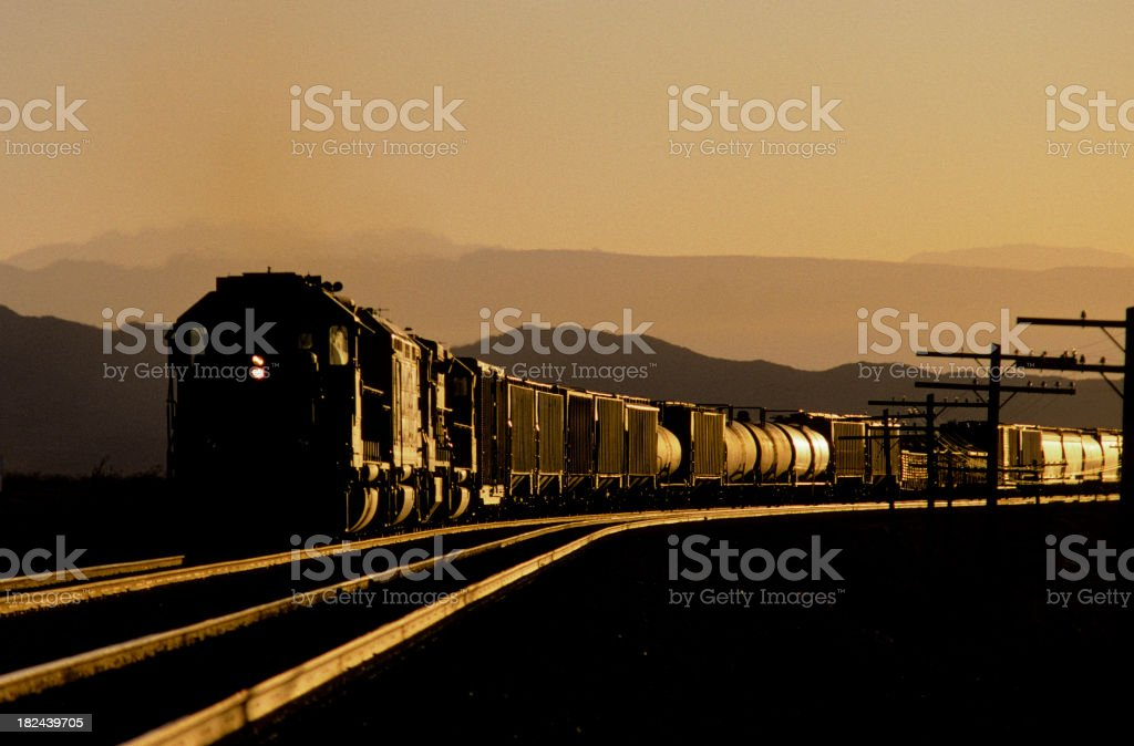 Train glinting in sunset royalty-free stock photo