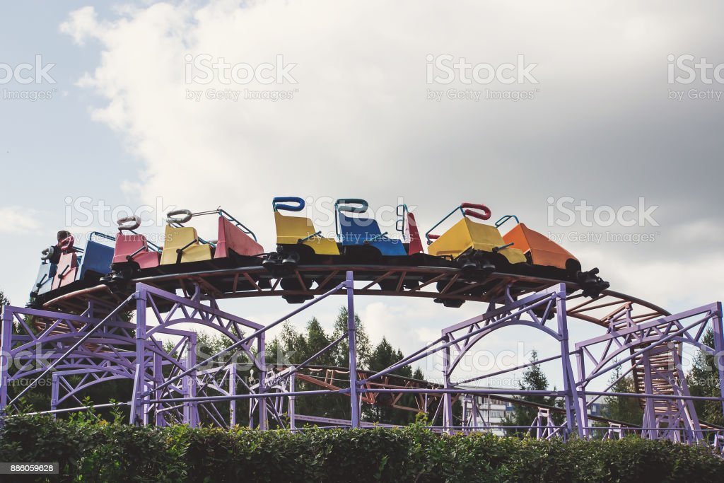 train goes up the stairs to the rides in the amusement Park stock photo