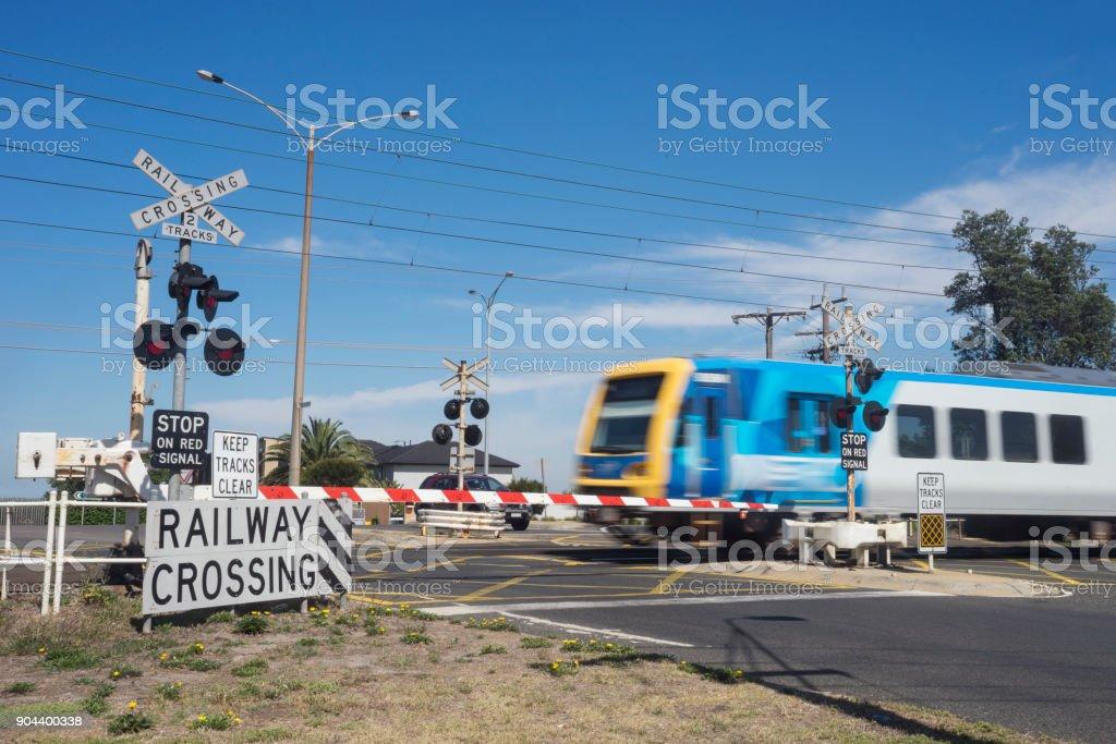 Train going through railway level crossing, Melbourne stock photo