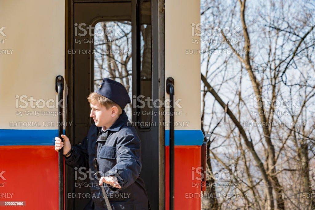 Train Guard on Gyermekvasút Railway in Budapest stock photo