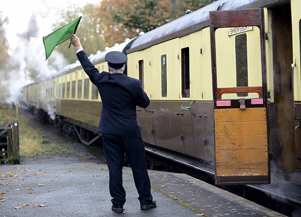 train guard - transport conductor stock photos and pictures