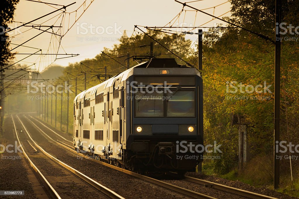 Train in autumn forest stock photo