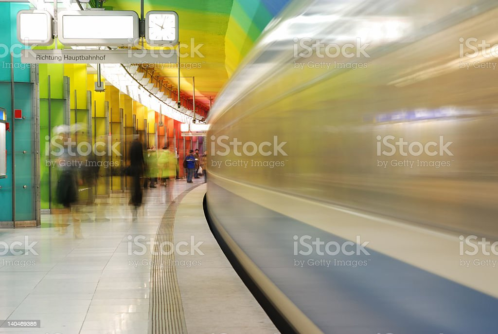 train in motion at colorful subway station stock photo