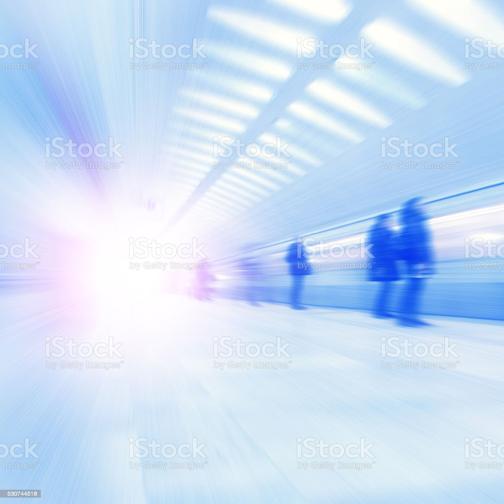 Train in motion blur and blurred people at subway. stock photo