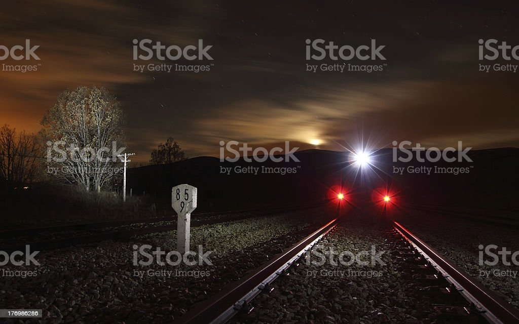 Train in night landscape False night train with beautiful scenery in the background. Backgrounds Stock Photo