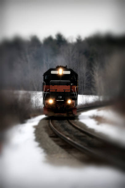 train in the forest rounding a bend stock photo