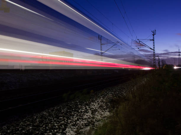 train in twilight train passing by fluchtpunktperspektive stock pictures, royalty-free photos & images