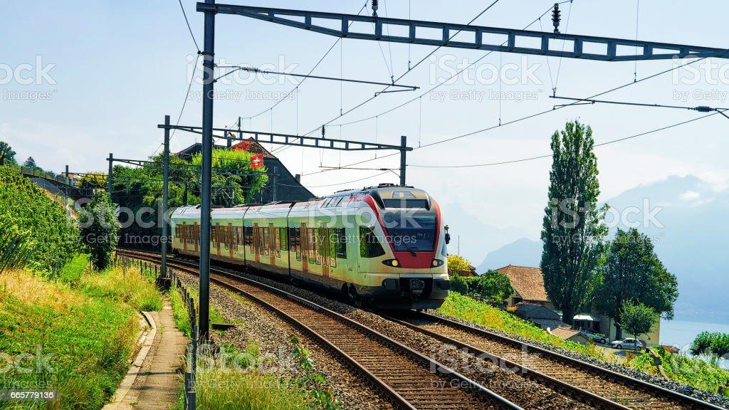 Train in Vineyard Terrace of Lavaux near Lake Geneva Alps stock photo
