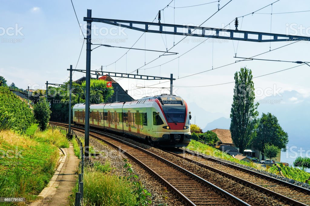 Train in Vineyard Terraces of Lavaux near Lake Geneva Alps stock photo