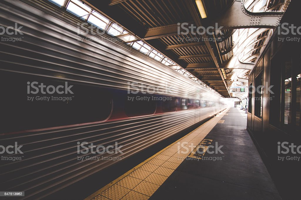 Train leaving station stock photo