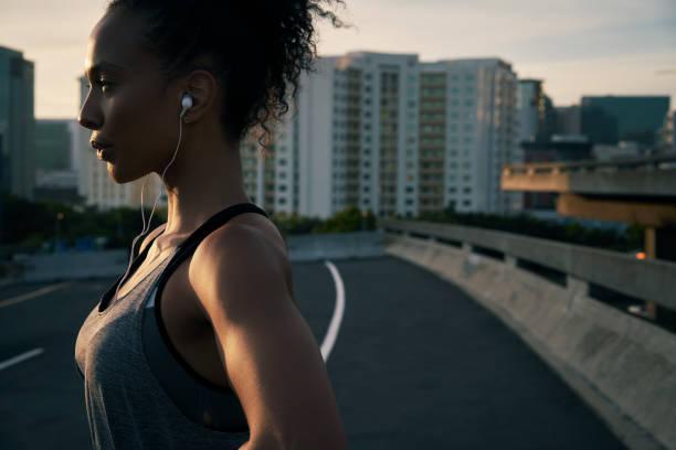 train like a beast - young woman running city imagens e fotografias de stock