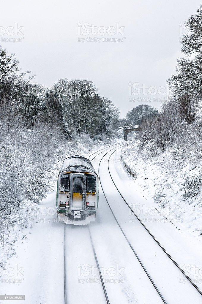 Train Making It's Way Through Winter Snow royalty-free stock photo