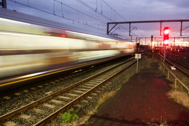train moving at night - railway signal stock photos and pictures