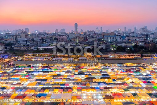 Train Night Market Rat-cha-da  at 7:00 pm, a gathering of food, clothing, jewelry. And many more, Thais and foreigners like to come in here, at Bangkok in Thailand.