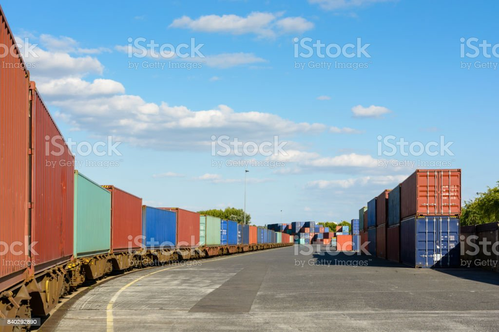 A train of containers parked in a shipping yard on the river Marne for the supply of supermarkets in Paris stock photo
