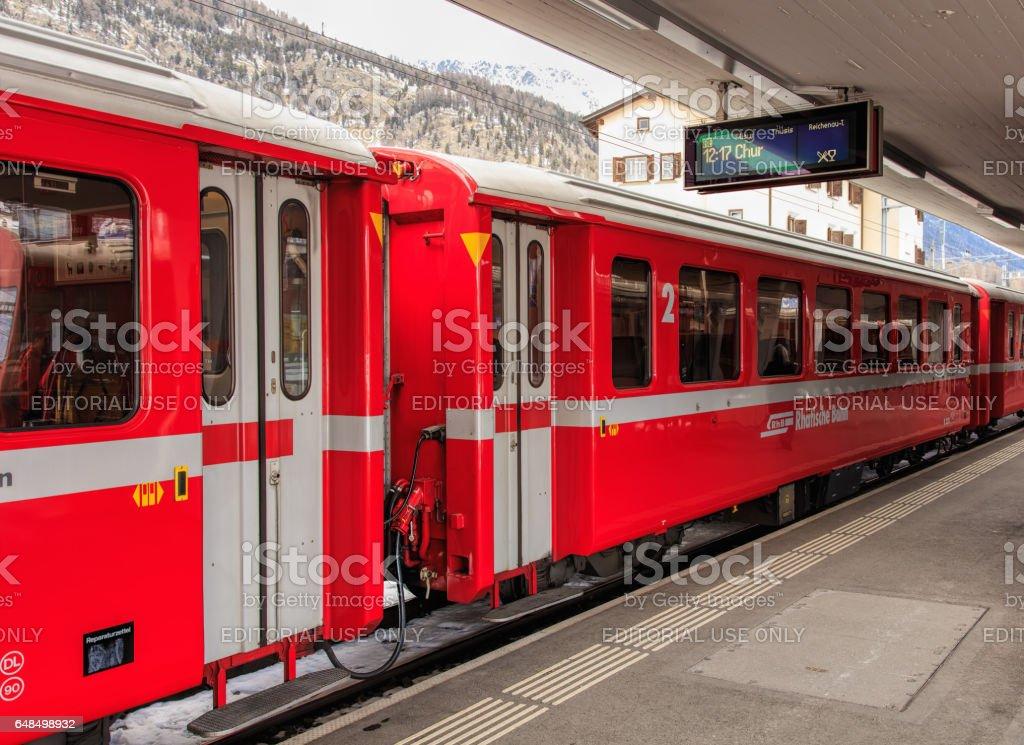 A train of the Rhaetian Railway at a platform of the Samedan railway station stock photo